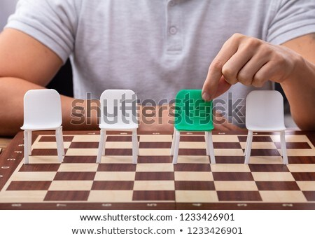 Man Choosing Green Chair On Chessboard Stock photo © AndreyPopov