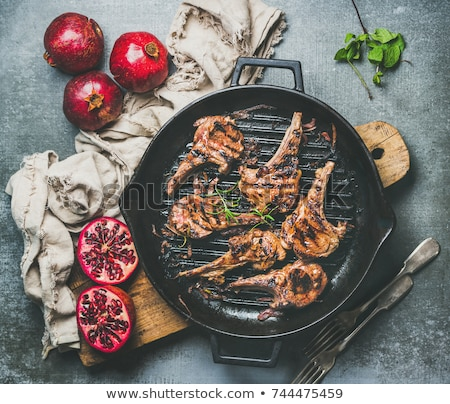 Grilled Lamb Chops and Barbecue on Wooden Board Stock photo © colematt