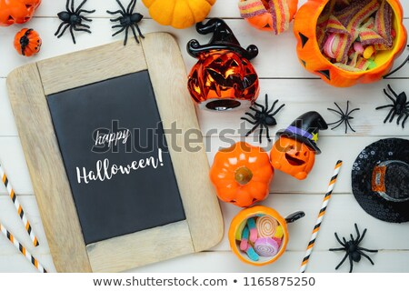 halloween decorations and candies wooden boards stock photo © dolgachov