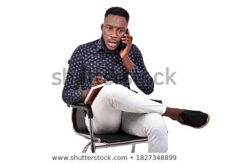 Homme séance président parler téléphone étonné Photo stock © feedough