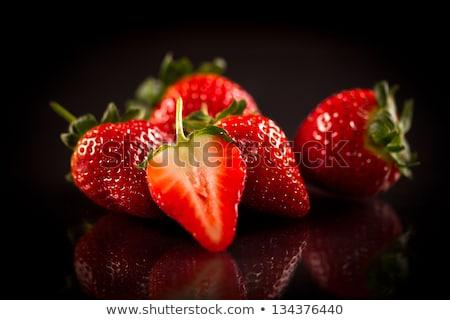 fresh ripe strawberries on black background stock photo © marylooo