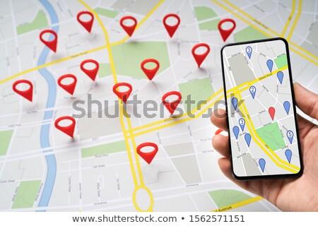 Persoon mobiele telefoon kaart navigatie iconen Stockfoto © AndreyPopov