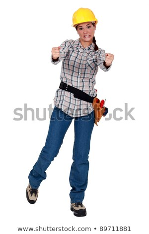 A female construction worker steering an invisible wheel. Stock photo © photography33