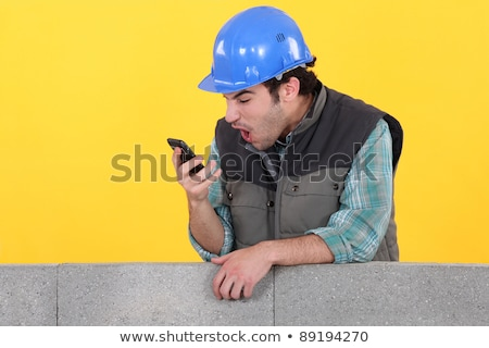 An astonished tradesman Stock photo © photography33