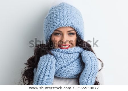 portrait of smiling young brunette in gloves stock photo © acidgrey