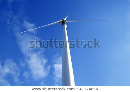 Electric wind mill viewed from the floor over blue sky Stock photo © lunamarina