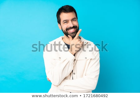Young smiling handsome guy Stock photo © stockyimages