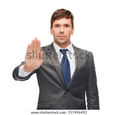 attractive buisnessman making stop gesture Stock photo © dolgachov