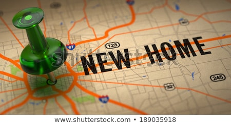New Home - Green Pushpin on a Map Background. Stock photo © tashatuvango
