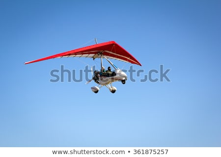 Flying Motorized hang glider  Stock photo © smuki