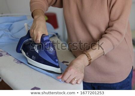 Woman ironing cloths Stock photo © imagedb