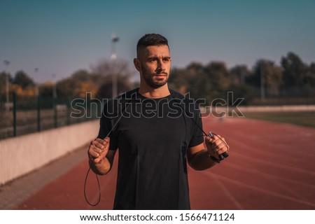 Muscular homem corda em torno de pescoço Foto stock © wavebreak_media
