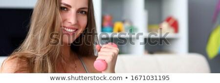 Portré csinos mosolygó nő sportruha nyújtás kéz Stock fotó © deandrobot