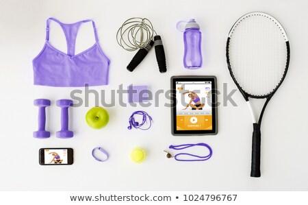 tablet pc, smartphone and sports stuff Stock photo © dolgachov