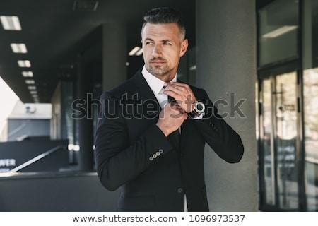 knap · jonge · zakenman · werken · laptop · beker - stockfoto © deandrobot
