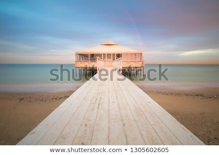 Romantic Pier on water with real Rainbow, long exposure, sunset  Stock photo © Taiga