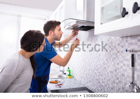 Technician Fixing Extractor Filter With Screwdriver Stock photo © AndreyPopov