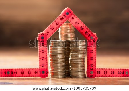 Coins Stack Under The House Made With Red Measuring Tape Stock photo © AndreyPopov
