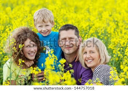 Happy family summer vacation. Mother with girl in rape field enjoying life at sunset. Pretty brunett Stock photo © ElenaBatkova