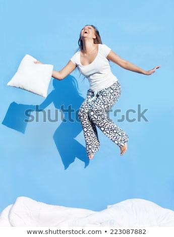 Feliz mulher azul travesseiro pessoas Foto stock © dolgachov