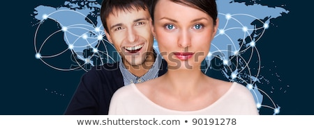Handsome friendly couple in futuristic interface standing in fro stock photo © HASLOO