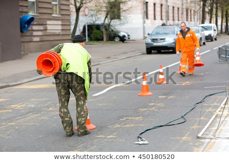 Worker with a traffic cone Stock photo © photography33