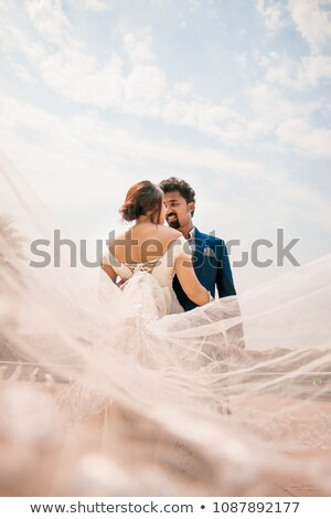 bride and groom on their wedding day blue sky background stock photo © victoria_andreas