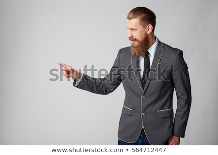 Businessman pressing imaginary button Stock photo © ra2studio