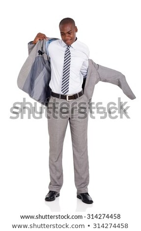 happy handsome businessman putting on suit jacket stock photo © deandrobot