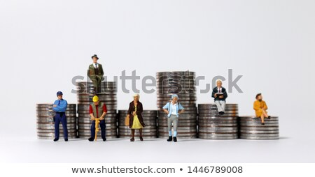 Various people standing on stacks of coins Stock photo © Kirill_M