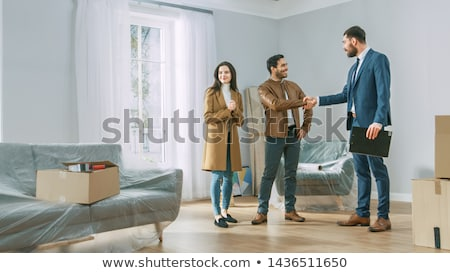A man showing the big house Stock photo © bluering