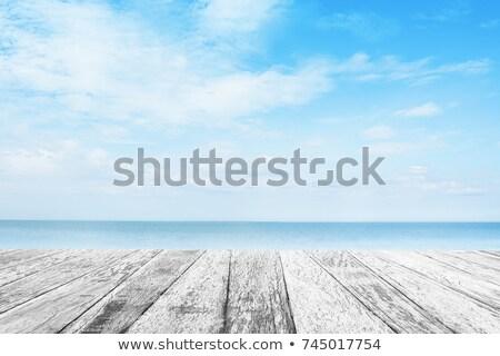 Fából készült felület óceán égbolt fölött háttér Stock fotó © compuinfoto
