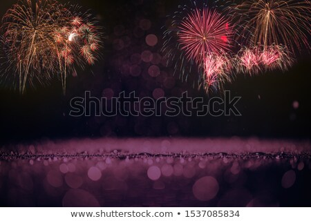 pezsgő · piros · zöld · citromsárga · tűzijáték · csillagos · ég - stock fotó © tasipas