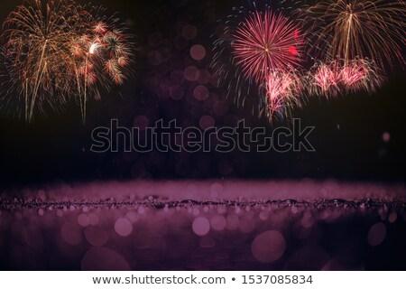 Blue green purple red yellow celebration fireworks  Stock photo © TasiPas