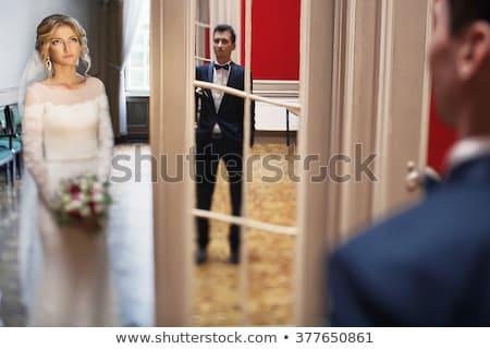 Paar poseren deuropening camera familie gezicht Stockfoto © tekso