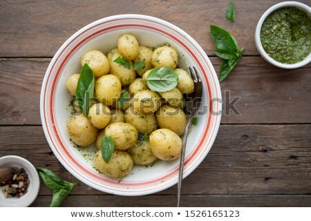 young potatoes in a clay bowl stock photo © supertrooper