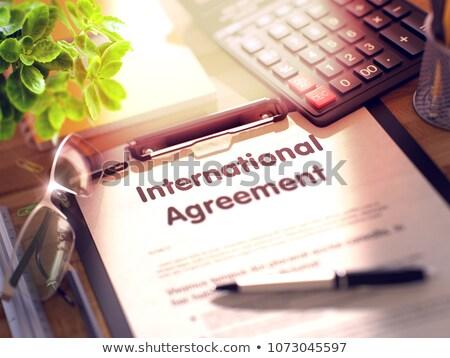 clipboard with international agreement 3d stock photo © tashatuvango