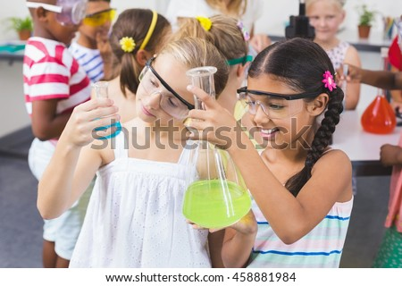 Girl and boy doing science experiment Stock photo © colematt