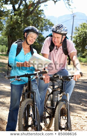 couple with map and bicycles at country in summer stock photo © dolgachov