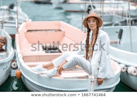 Joven blanco traje popa placer barco Foto stock © ElenaBatkova
