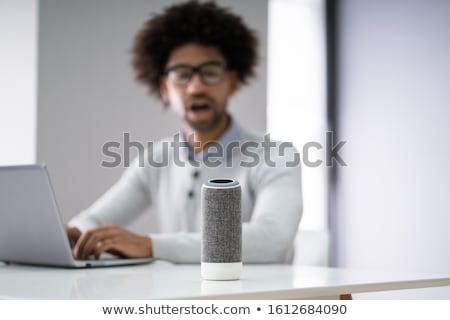 Adam dinleme akıllı konuşmacı ses Stok fotoğraf © AndreyPopov