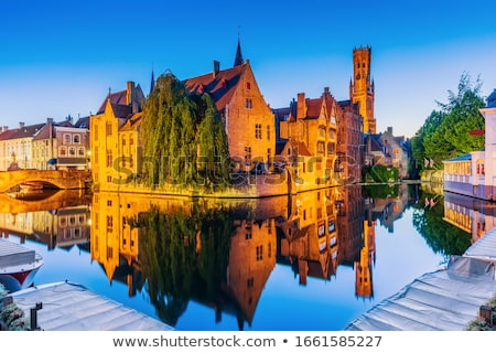 Church of Our Lady and canal. Brugge Bruges, Belgium Stock photo © dmitry_rukhlenko