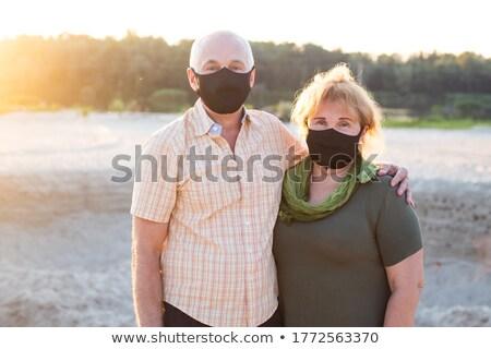 Coronavirus. Man in quarantine for coronavirus wearing protective mask. She's working from home and  Stock photo © galitskaya