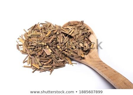 Dried lemongrass on wooden spoon stock photo © Amaviael