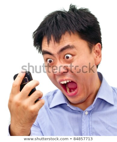 Closeup of a man shouting into his cellphone Stock photo © photography33