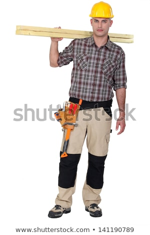 man carrying two wooden plans over shoulder stock photo © photography33