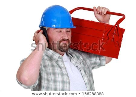 Tradesman pretending to listen to music Stock photo © photography33