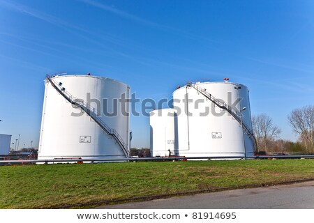 Stock photo:  large white tanks for petrol and oil