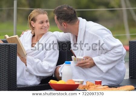 Casal café da manhã mulher homem café alimentação Foto stock © photography33