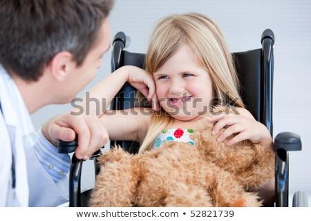 Riendo nina sesión silla de ruedas hospital nina Foto stock © wavebreak_media